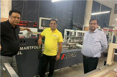 (l-r) Kapil and Komal Kalra of Dimple Packaging with Puneet Aggarwal of DGM India