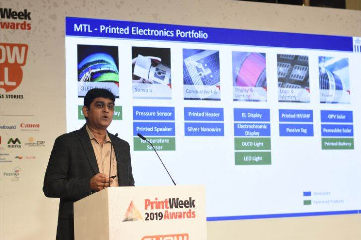 Shashi Ranjan of Manipal Technologies showcases its eco-friendly use of printed electronics, where it created a display for GSK without LED light, but using electroluminescent (EL) ink that glow
