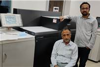 (l-r) Tarsem Lal Goyal and Parag Goyal of Creative Offset Printers with the Canon 10000 VP