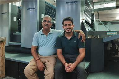 Soni (l), his son Rahul with the new Heidelberg CS 92 press