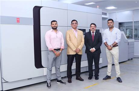 (l-r) Sanandan Seth, director, and Bhuvnesh Seth, managing director, Replika Press, with Puneet Datta, senior director, Canon India and Vikaran Seth, director, Replika Press