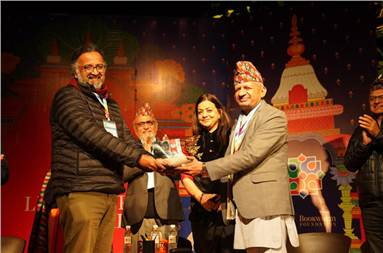 Amitabha Bagchi, winner of the DSC Prize 2019, receives the trophy from Pradeep Gyawali, Minister of Foreign Affairs of Nepal