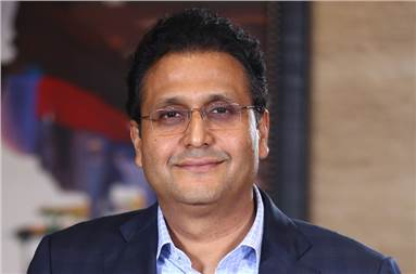 Girish Agarwaal is the promoter director of DB Corp