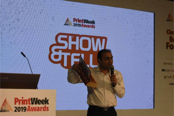 Manu Choudhury of CDC Printers showcases a wedding invite in the form of a book