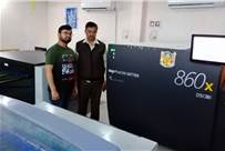 (l-r) Sahil Dadwal and Anoop Kumar of Sahil Processors with the new machine