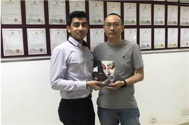 (L-r) Akshat Pardiwala of Nippon Color and Frank Xu of Coaso hold a book with cover printed on Coaso's iCuejet 370