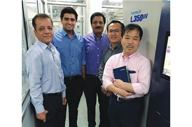 Manish Hansoti (c) with his colleagues at S Kumar