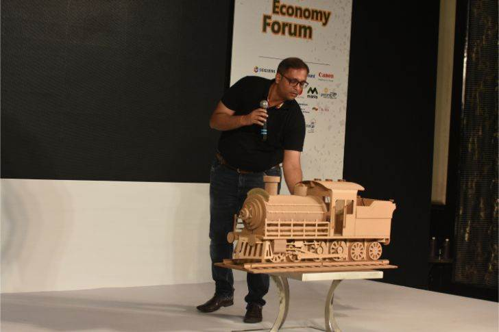 Jigar Shelugar of Spectrum Scan demonstrates who the company created a life-size train out of corrugation