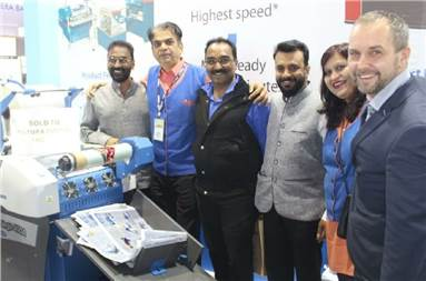 Caption: Parag Shah (second from left) with the Futura Digital team and Foliant laminator