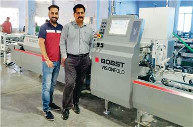 Sahil and Rajiv Sahni of Sawhney Paper Products with the BobstVisionfold 80 A2 folder-gluer