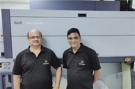 Printronics engineers with the newly installed Durst Tau330 RSC