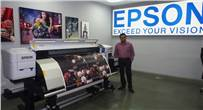The company is looking at show-and-tell plus demos of its signage and décor printers