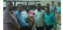 Ashish Save of Insight Communications presenting a bouquet to A Nagaraj and A L Kumar of Signage Graphics. Also seen: George Mathew and M Basha of Insight Communications
