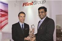 Kapil Vaidya, a partner at Sonic Labels, received the Award from Guillaume Clement, president for Global Narrow Web at Flint Group