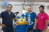 Representatives from Brandigo, Hi-Tech and Foliant with the machine