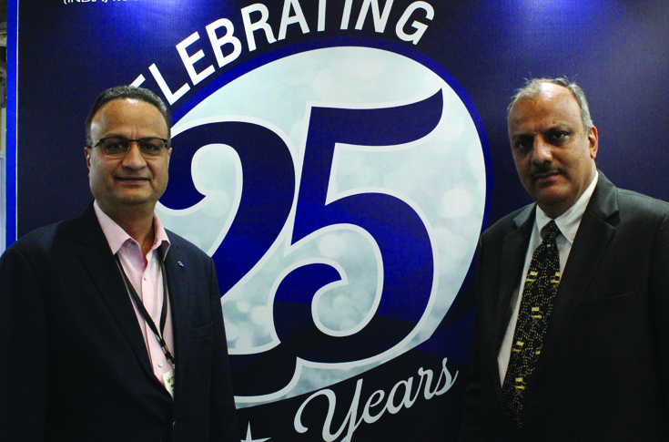 Manish Mehta, managing director, Reifenhauser India Marketing, with his brother during the show