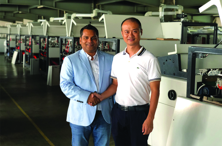 (l-r) Rananjay Anand of Druck & Bindung Machinery with Huang Cheng, managaing director,  Wenzhou Gaosheng Machinery, China