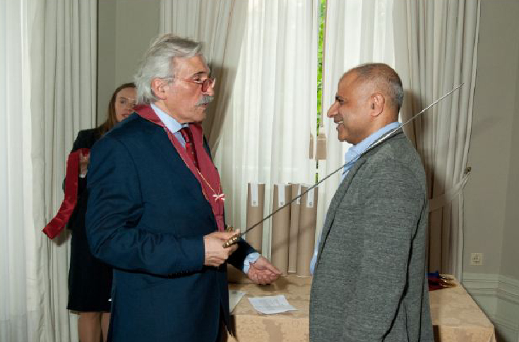 Munish Aggarwal receiving the Knighthood from  Prof Luiz Humberto Jardim Marcos