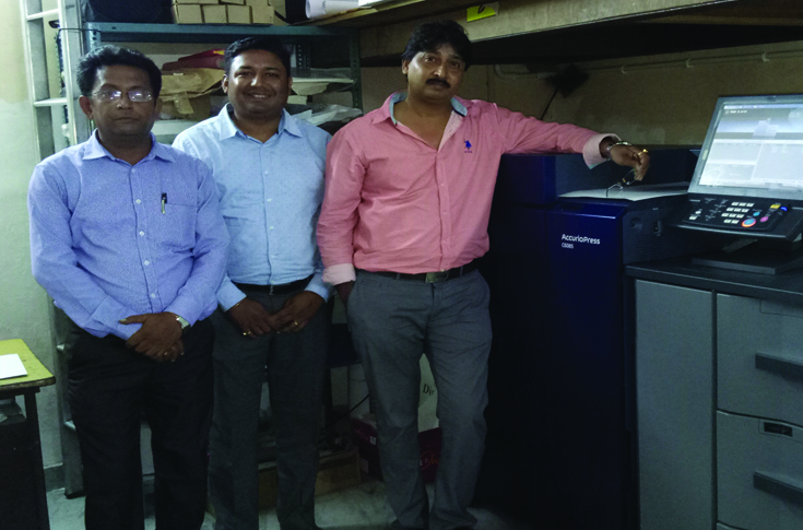 (l-r) Malay Paul and Aloke Hazarika of Konica Minolta with Surojit Das, proprietor, RM Enterprise
