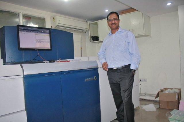 Praveen Agarwal with the newly acquired Xerox Versant 80