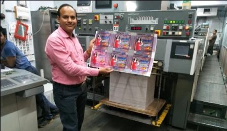 Prashant Manoj Patel of Pradipam Offset with a print sample