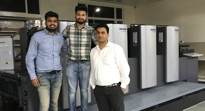 (L-R) Girish Mittal and Hitesh Mittal with Sunil Kumar of Heidelberg India with the Speedmaster SX 74