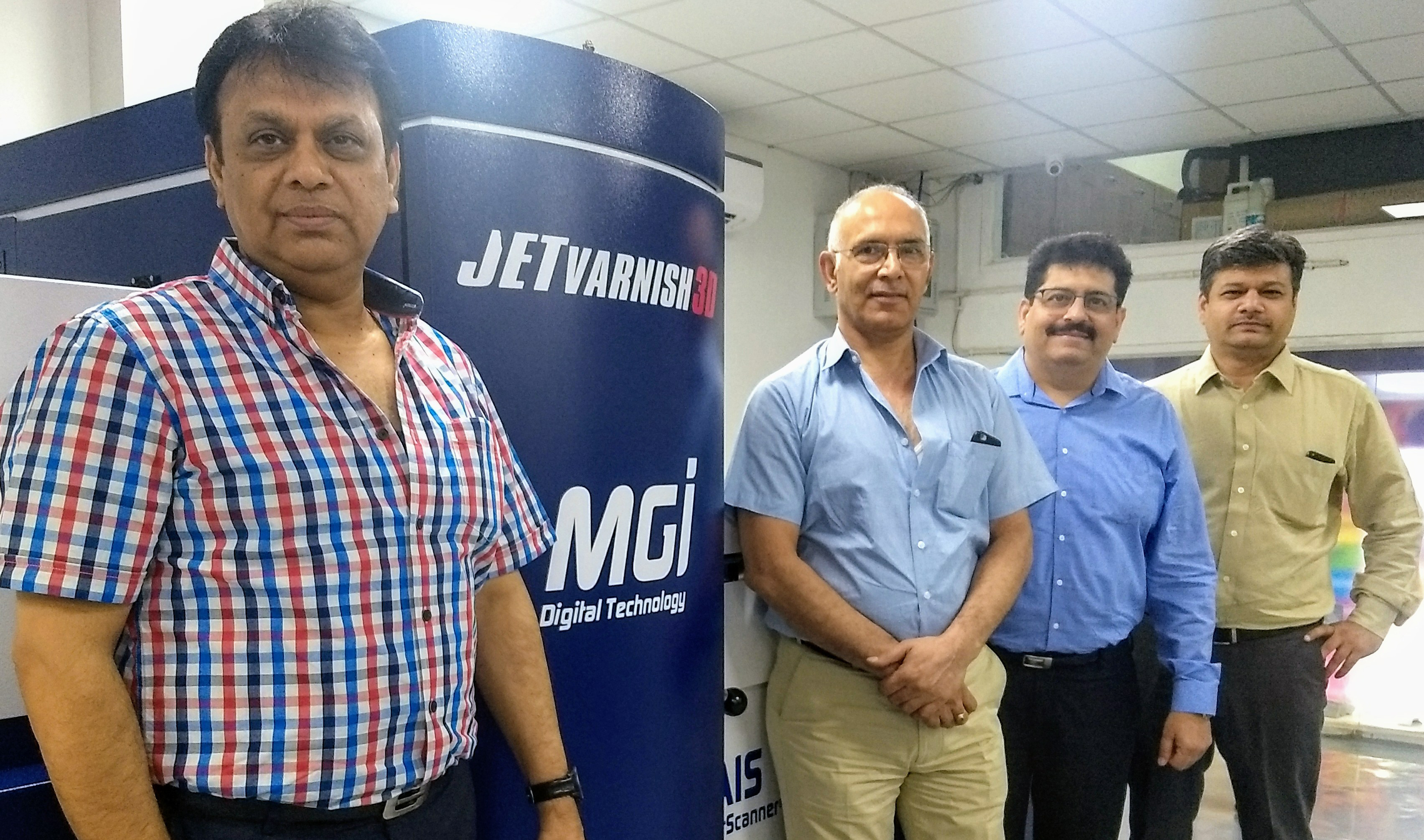 (from left) Kamal Malik and Ravinder Kumar of Printology Xperts, and Rajeev Ahuja and Manish Gupta of Konica Minolta