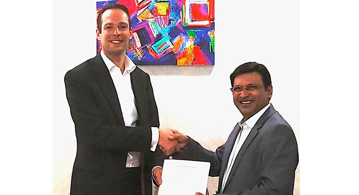 Oliver Bruns (l) of Edelmann Group with Anil Kumar of MK Printpack