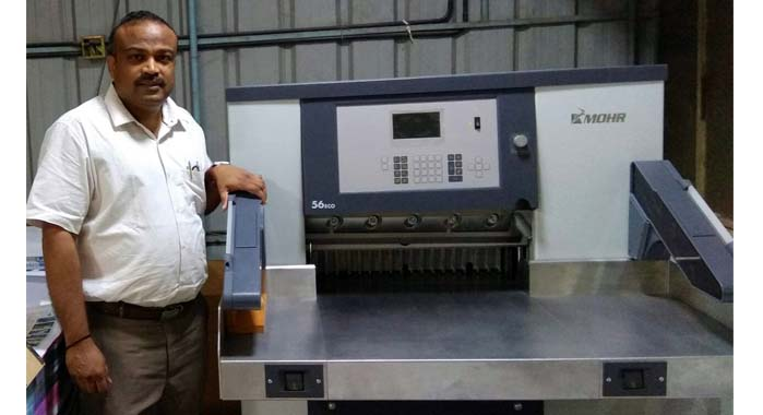 G Venugopal, executive director, Sterling Print House with the Mohr cutting machine