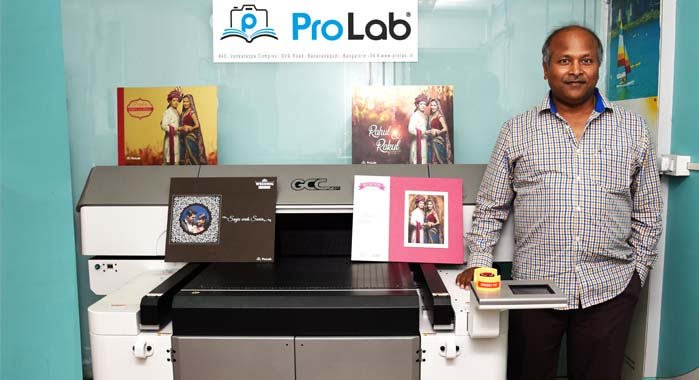 P Naveen Kumar of Pro Lab with the GCC UV flatbed printer