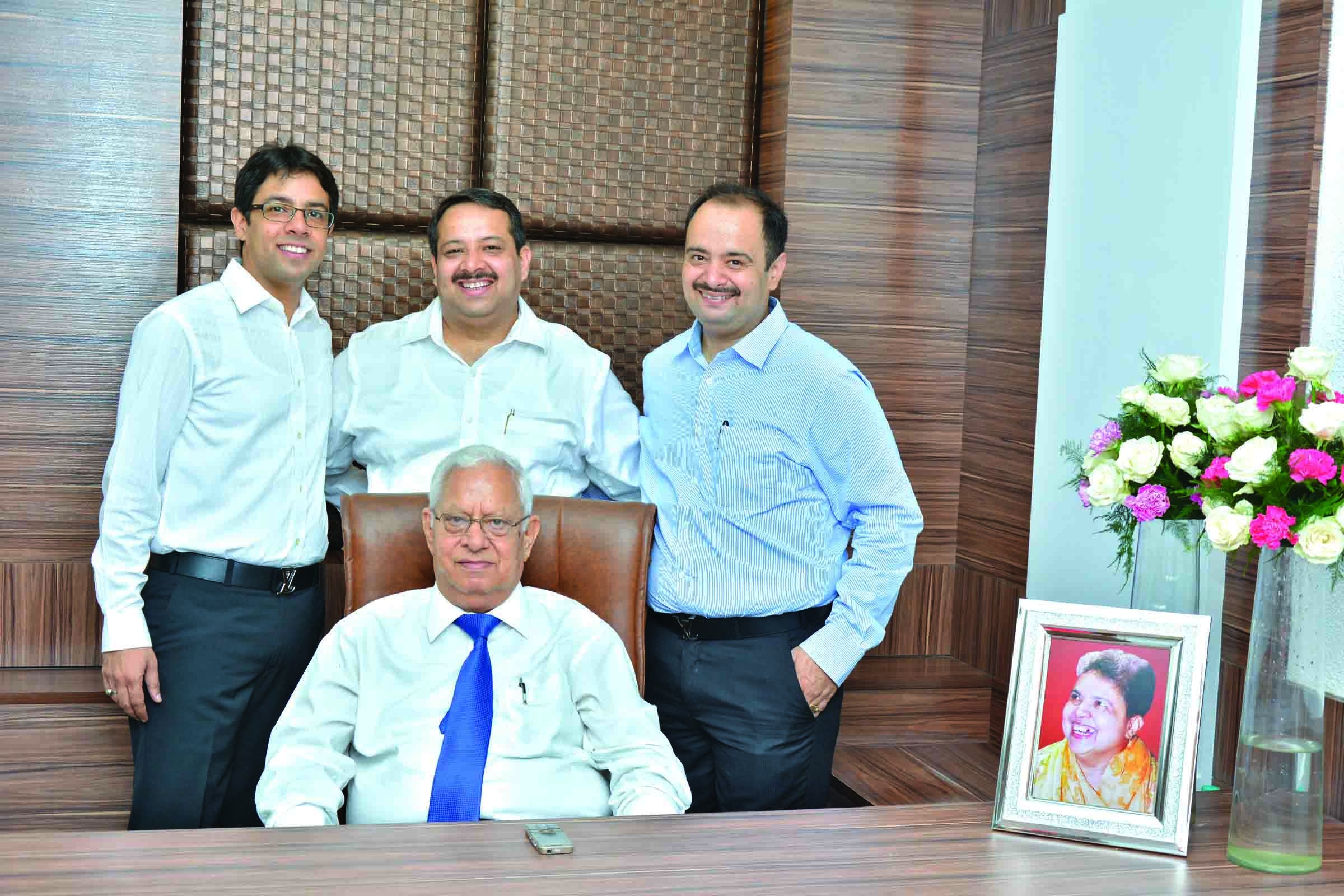 Standing (l-r): Brothers Vikas, Amit and Aman with father (sitting), Satish Gulati