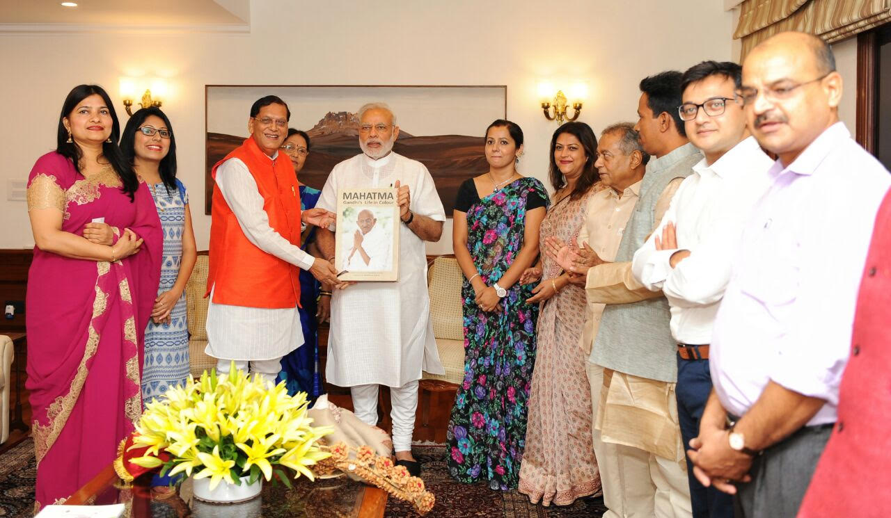 The first copy of the book presented to the Prime Minister