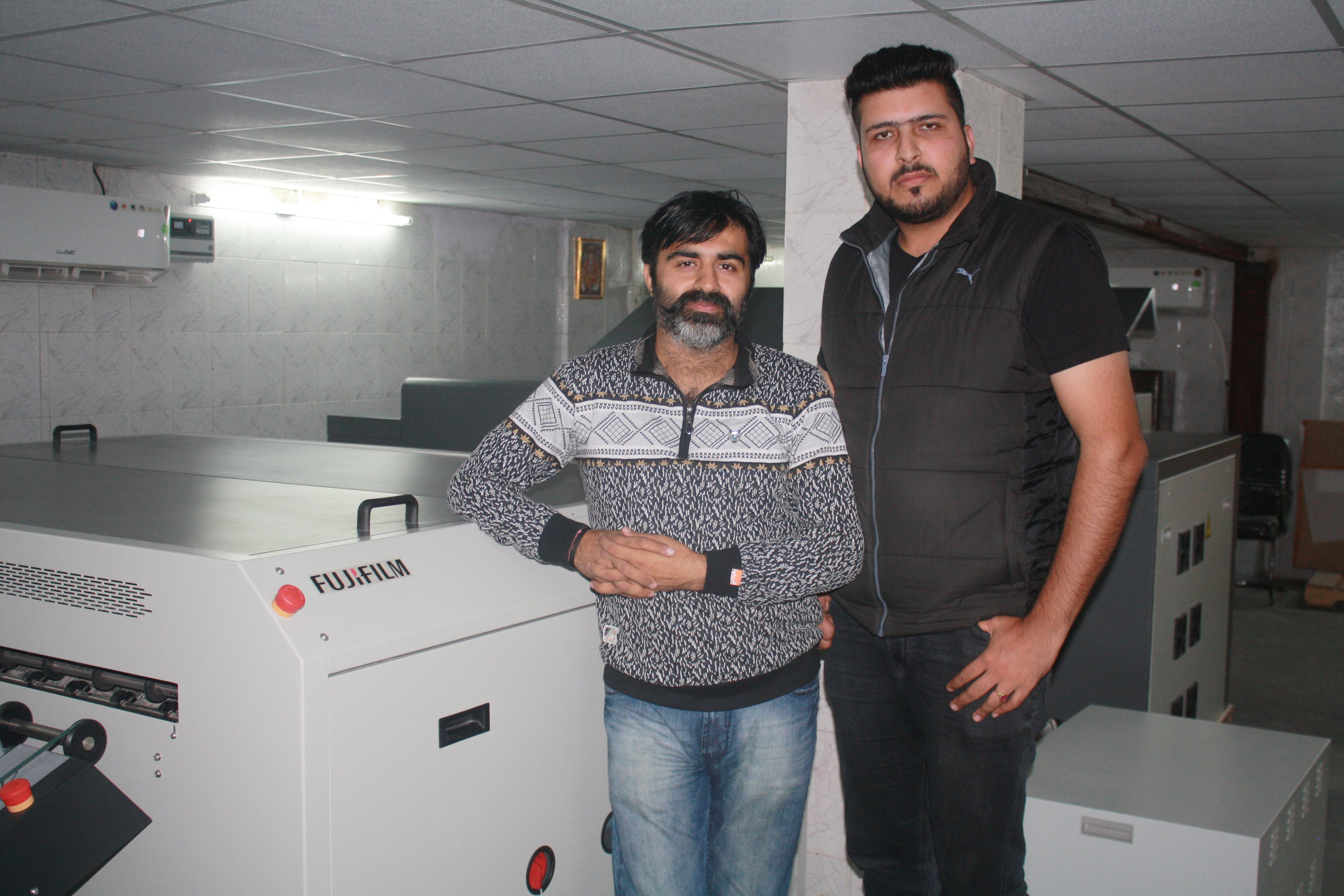 Masoom (left) and Pankaj with the Fujifilm CTCP